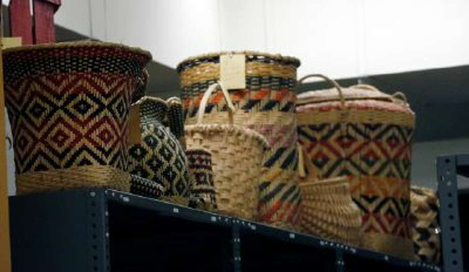 In this Oct. 11, 2013 photograph, Mississippi tribes of Native American-made baskets line the tops of shelves in storage and will be among the items that will eventually be displayed in one of two museums planned for Jackson, Miss.
