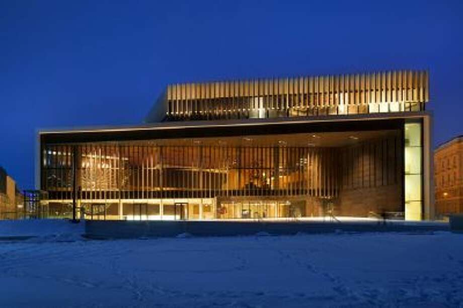 """The new opera house by architect Terry Pawson is shown in Linz, Austria, on Feb. 25. The first opera to be performed there was """"The Lost"""" by Philip Glass."""
