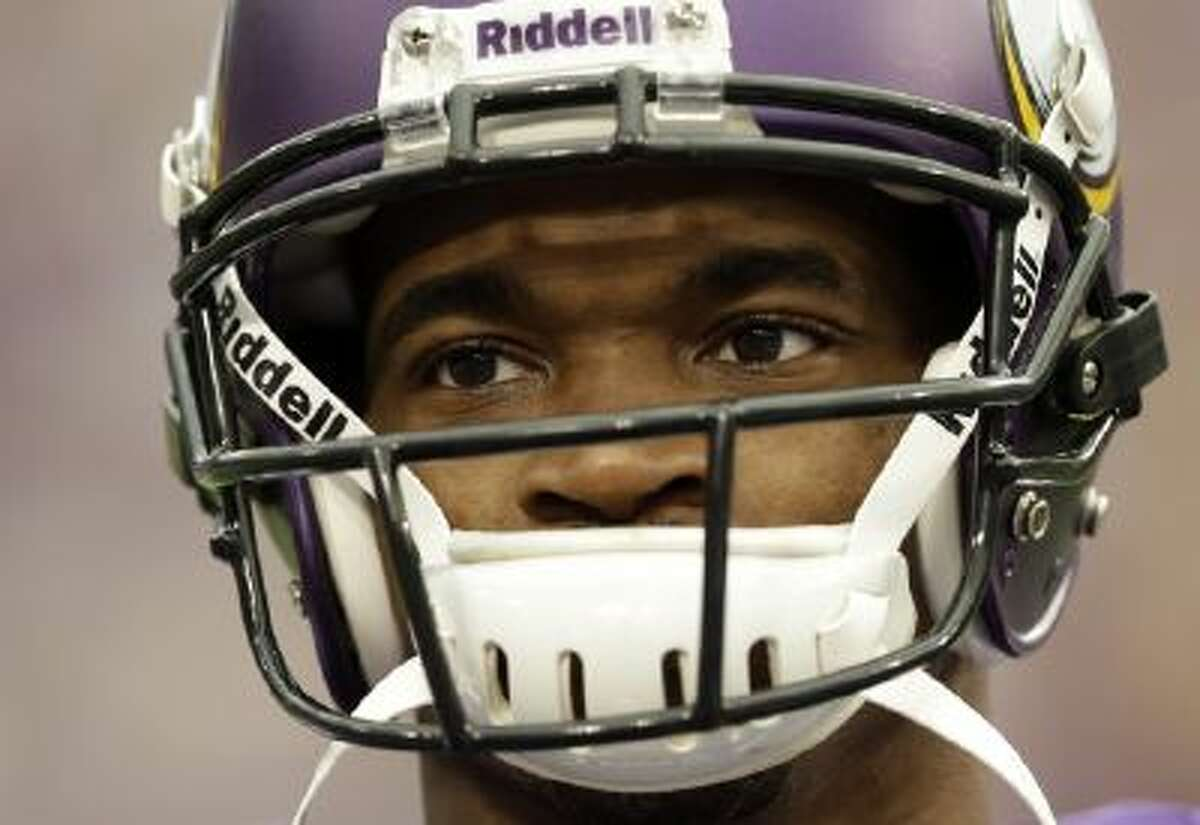 Minnesota Vikings running back Adrian Peterson pauses during introductions before an NFL football game against the Carolina Panthers in Minneapolis, Sunday, Oct. 13, 2013. One of the star running back's sons, a 2-year-old in South Dakota, died Friday after an alleged attack in a child abuse case.