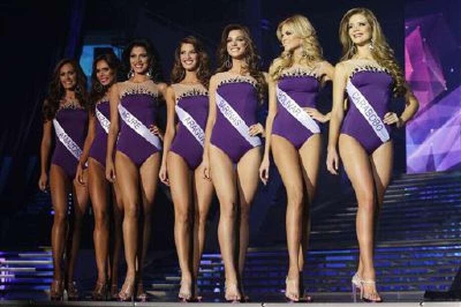 Contestants pose during the Miss Venezuela beauty pageant in Caracas, Venezuela, Oct. 10. Photo: AP / AP