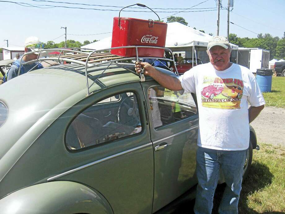 Photo by John TorsielloBug In organizer Chuck Pisconsky proudly displays his 1950 Beetle. Photo: Journal Register Co.