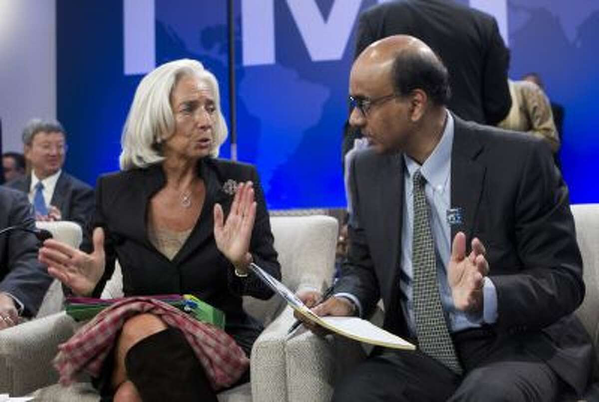 International Monetary Fund (IMF) Managing Director Christine Lagarde, speaks with Singaporean Minister for Finance Tharman Shanmugaratnam, who is also the chairman of the IMFC, before a meeting of the IMFC, during the World Bank/IMF Annual Meetings at IMF headquarters, Saturday, Oct. 12, 2013, in Washington.