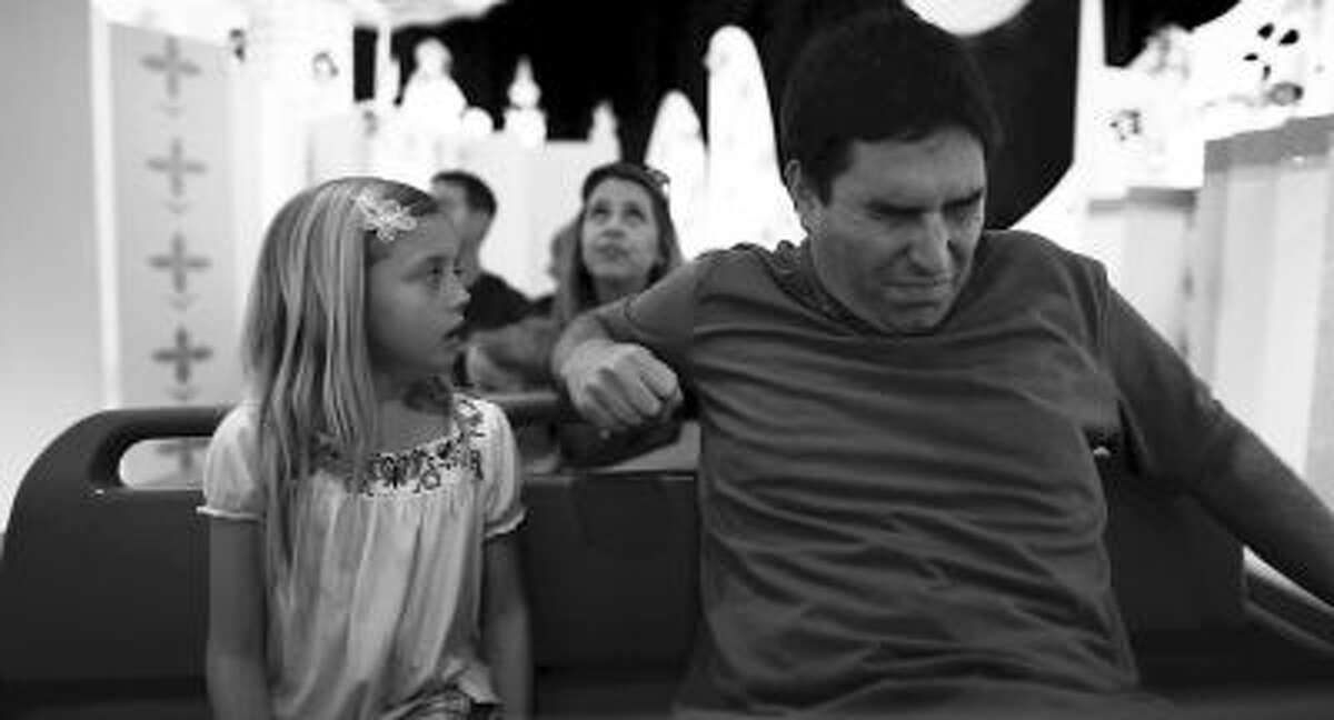 """This undated photo released by Mankurt Media, LLC shows Roy Abramsohn as Jim freaking out during a ride in the amusement park on the last day of his family vacation in a scene from """"Escape from Tomorrow,"""" a feature film by writer/director Randy Moore."""