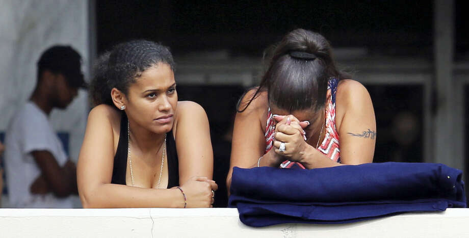 Concerned friends and family of victims at the Pulse nightclub, where multiple fatalities were reported after a shooting, wait outside of the Orlando Police Department, Sunday, June 12, 2016. (Joe Burbank/Orlando Sentinel via AP) MAGS OUT; NO SALES; MANDATORY CREDIT Photo: AP / Orlando Sentinel