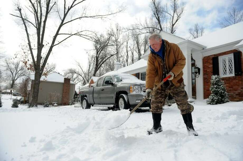 Gary McMillan, 73, of Paducah, Ky., shovels snow at his home in Paducah on Monday, March 3, 2014. A winter storm brought ice, sleet and snow to the region hampering travel and business. Area colleges, school and shopping centers have closed. (AP Photo/Stephen Lance Dennee) Photo: AP / FR170568 AP