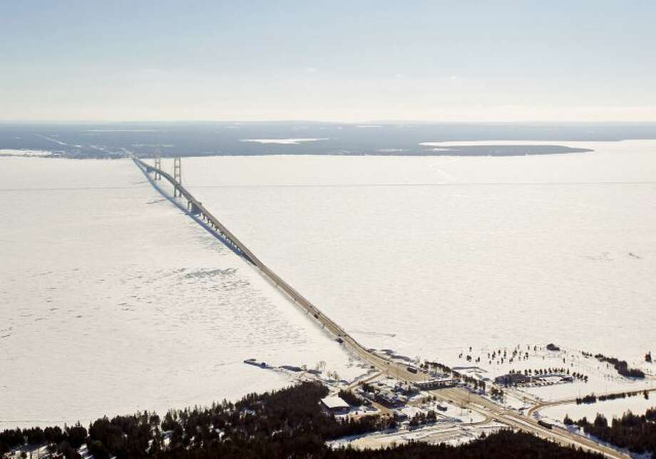 In this Feb. 11, 2014 aerial photo is a view of The Mackinac Bridge which spans a 5-mile-wide freshwater channel that separates Michigan's upper and lower peninsulas. The straits is drawing the attention of some who consider the twin 20-inch pipes that stretch across the bottom of the waterway, carrying nearly 23 million gallons of crude oil daily, a symbol of the dangers lurking in the nation's sprawling web of buried oil and natural gas pipelines. (AP Photo/ Traverse City... Photo: AP / POOL Traverse City Record-Eagle