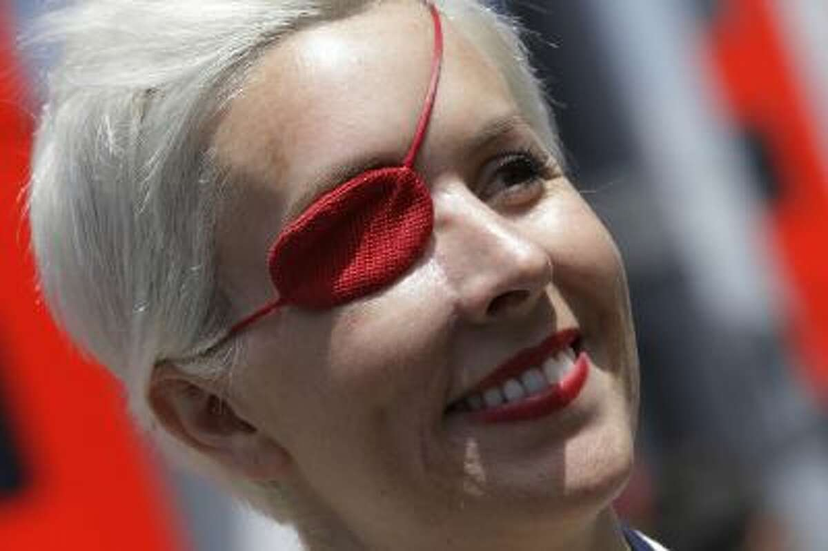 FILE - In this May 11, 2013 file photo, Spanish former F1 driver Maria De Villota smiles in the paddock at the Catalunya racetrack in Montmelo, near Barcelona, Spain. Spanish police have confirmed that racing driver Maria de Villota has been found dead in a hotel room in Seville, and say it appears she died of natural causes. She was 33. In July 2012, De Villota crashed while test driving a car for F-1 team Marussia. She lost her right eye in the accident.
