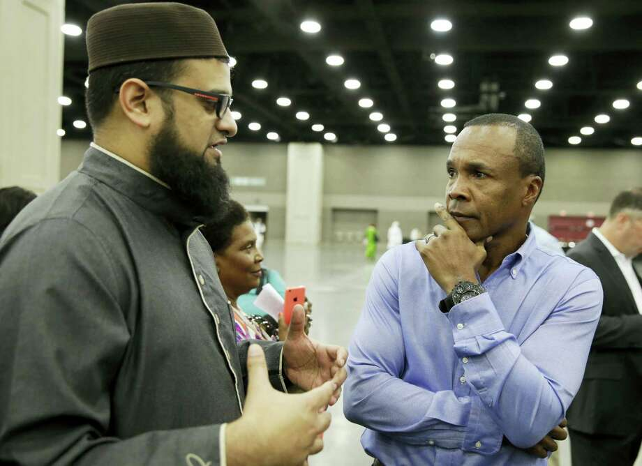Safih Amed, left speaks with former boxing champion Sugar Ray Leonard before Muhammad Ali's Jenazah, a traditional Islamic Muslim service, in Freedom Hall, Thursday, June 9, 2016, in Louisville, Ky. (AP Photo/Darron Cummings) Photo: AP / AP