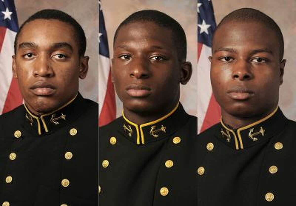 This combination of July, 24, 2013 photos provided by the U.S. Navy football team show, from left, Midshipmen Tra'ves Bush, Josh Tate and Eric Graham. Graham, of Eight Mile, Ala., and Tate, of Nashville, Tenn., will face a court-martial in an alleged sexual assault at an off-campus party in April 2012 while Bush, of Johnston, S.C., will not, the U.S. Naval Academy superintendent said Thursday, Oct 10, 2013. All three midshipmen were former Navy football players. (AP Photo/U.S....