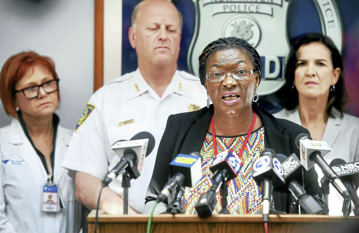 (Arnold Gold-New Haven Register) Dr. Martha Okafor (center), Community Services Administrator, speaks at a press conference at the New Haven Police Department on 6/24/2016 concerning the spike in synthetic drug overdoses in New Haven and surrounding towns.
