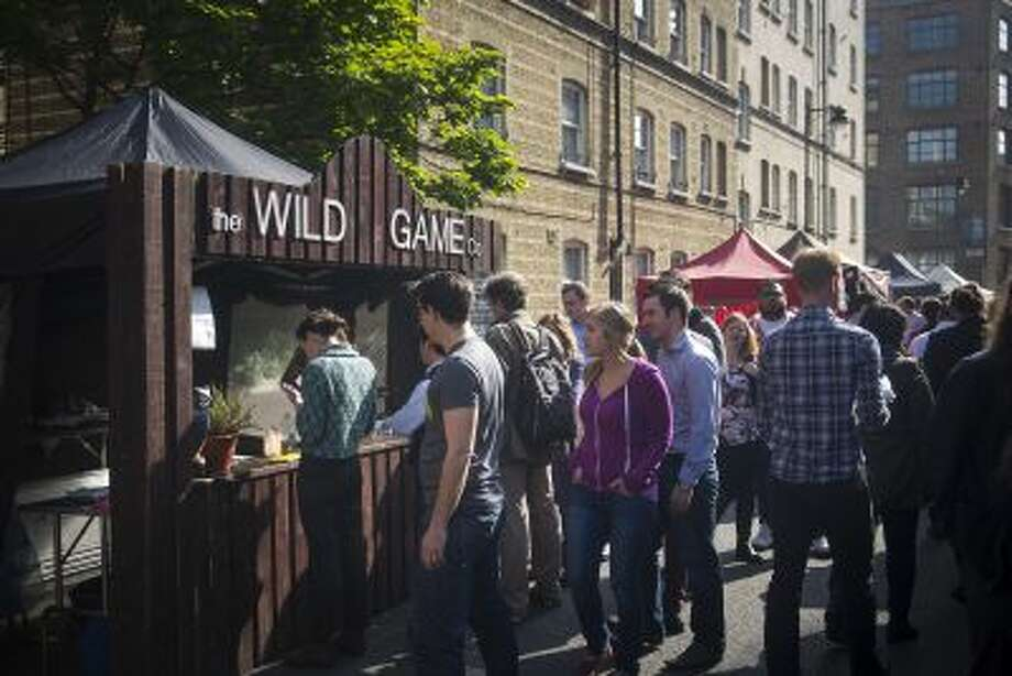 Patrons line up at the Wild Game Co. stall on Whitecross Street in London; Wild Game won the 2012 Young British Foodies street food award. Photo: THE WASHINGTON POST / THE WASHINGTON POST