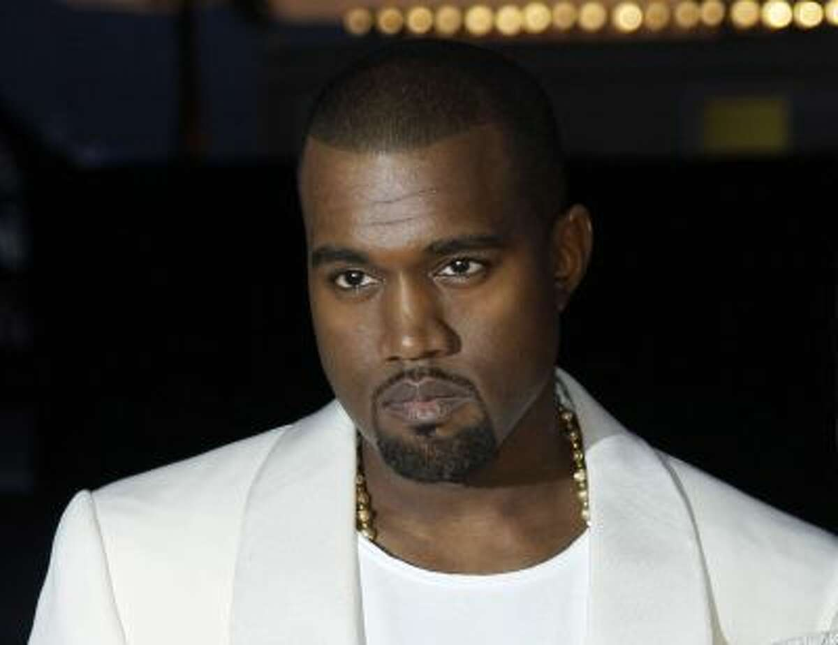 """In this May 23, 2012 photo, singer Kanye West arrives for the screening of """"Cruel Summer"""" at the 65th international film festival, in Cannes, southern France. (AP Photo/Francois Mori, File)"""