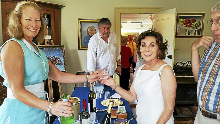 """Photo by N.F. AmberyColebrook Historical Society President Carol Lord serves beverages to visitors at the Historical Society's 2016 group art show """"Artists Abound"""" at 558 Colebrook Road in Colebrook on Sunday afternoon. About 300 people attended the open house and art show and sale that featured 20 local artists and craftspeople. Photo: Journal Register Co."""