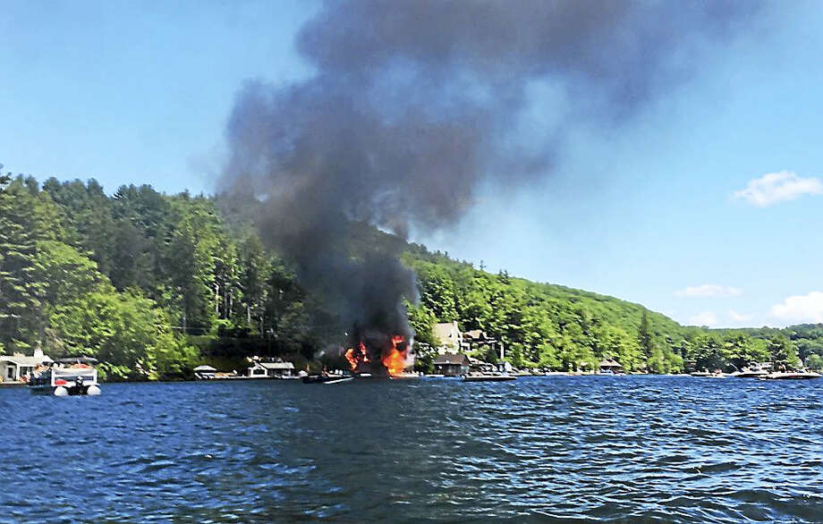 (Photo courtesy of Jessica Mae Chung)A summer cottage on the west shore of Highland Lake in Winsted will have to be torn down after a fire broke out there Sunday. Photo: Journal Register Co.