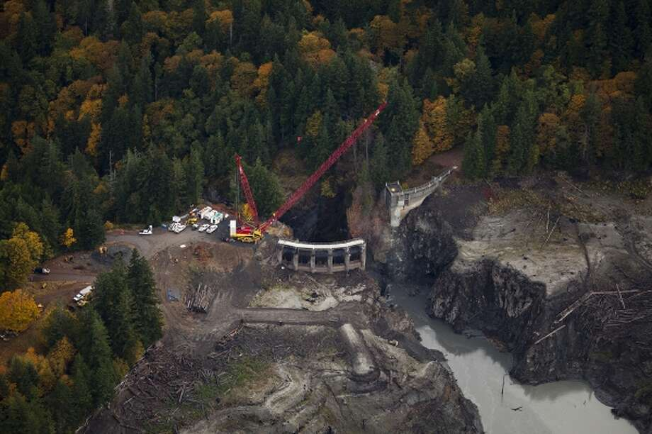 Construction crews work on removal of the Glines Canyon Dam, near Port Angeles, Wash., in October 2012. Scientists hope the dam removal project will restore the salmon population of the Elwha River. Photo: The Washington Post / THE WASHINGTON POST