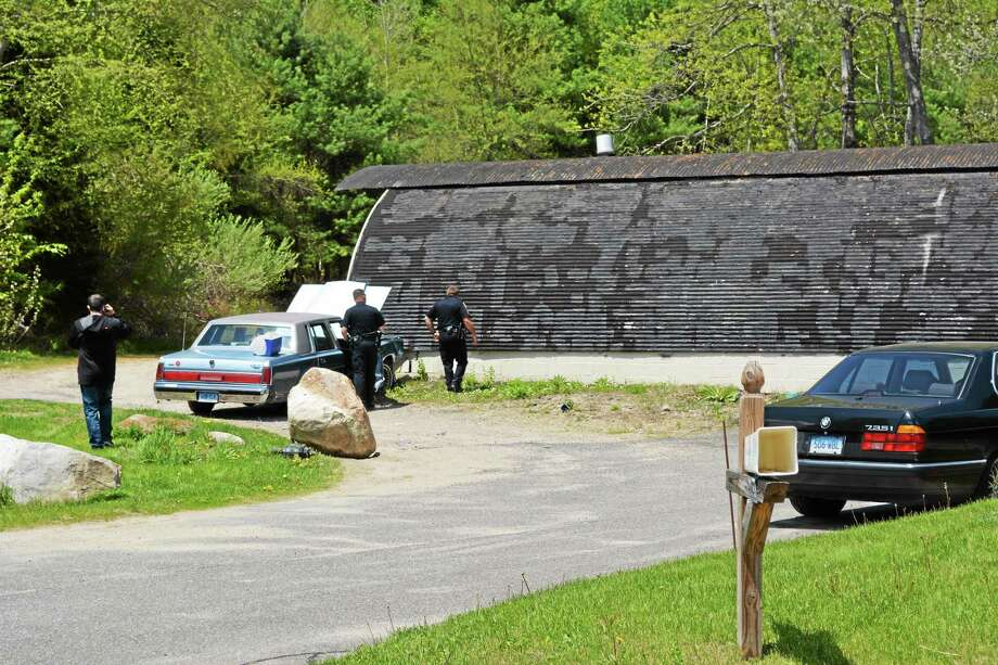 Officers processing the scene of the accident at 3251 Winsted Road Monday afternoon. Photo: Jenny Golfin — Register Citizen