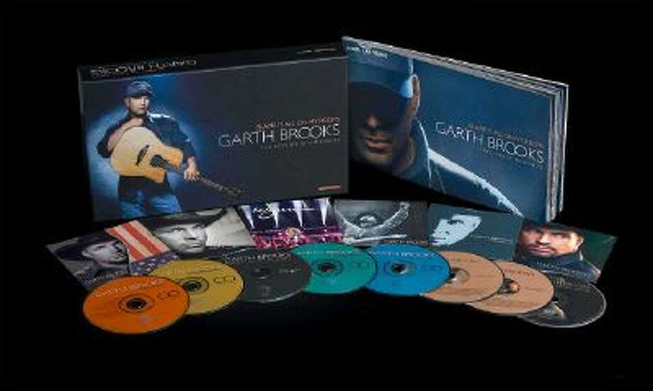 """This photo provided by Pearl Records Inc. shows the boxed music set of CDS and DVDs for Garth Brooks' """"Blame It All On My Roots."""" In stores Thursday, Nov. 28, 2013, it's an eight-disc box set containing a blast of newly recorded material."""