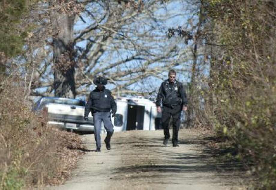 Virginia State police investigators and local police at the home of Virginia State Sen. Creigh Deeds in Millboro, Va., Tuesday, Nov. 19, 2013. The son of Deeds stabbed his father in the head and chest before apparently killing himself with a gun, according to initial reports from police.