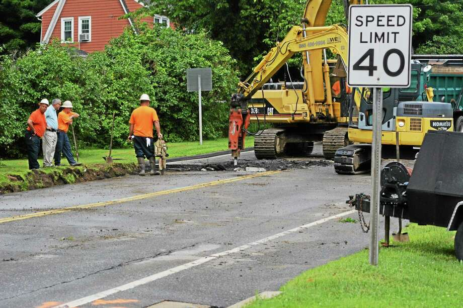 A water main break has shut down part of Goshen Road in Torrington. Police say the road could be closed for most of the day as repairs are made. (Photo by Jenny Golfin - Register Citizen). Photo: Journal Register Co.