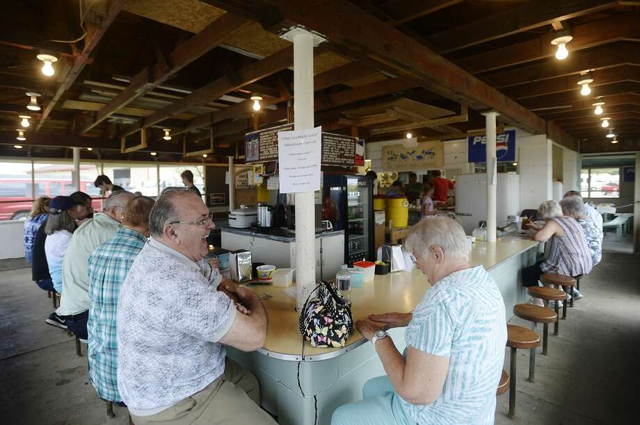Don Murphy of Midland, left, and Nancy Pahl of Hemlock, right, catch up after running into each other for the first time in at least 50 years at the Studley Grange concession stand at the Midland County Fairgrounds on Wednesday, August 16, 2017. Photo: (Katy Kildee/kkildee@mdn.net)