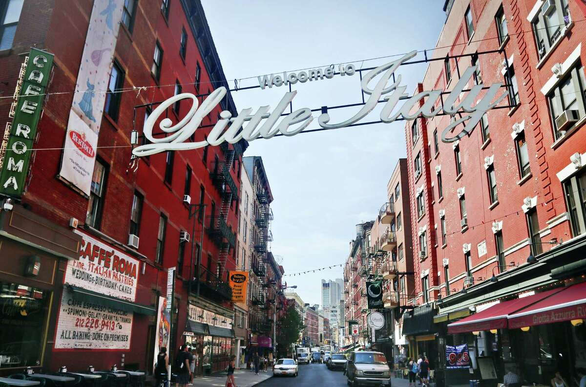In this Tuesday, Aug. 9, 2016 photo, an overhead sign welcomes visitors to Little Italy, near the Cafe Roma, at the corner of Broome and Mulberry Streets, in New York. In a conversation with an undercover FBI agent, reputed mobster Eugene