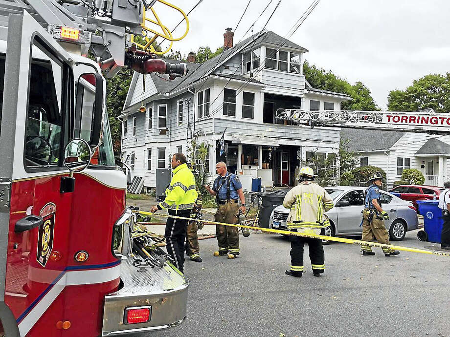 (Ben Lambert/The Register Citizen) Torrington fire crews battled a two-alarm house fire at 170 Park Ave. early Wednesday afternoon. Photo: Journal Register Co.