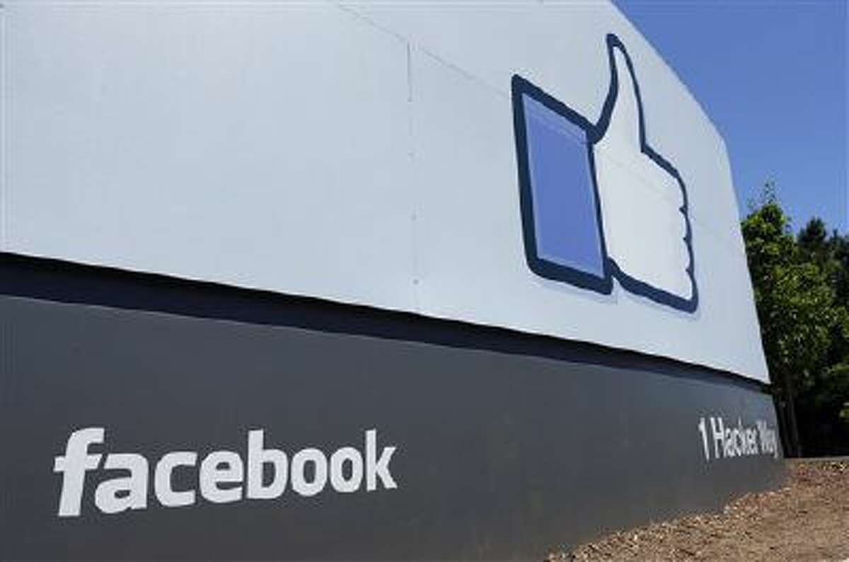 This July 16, 2013, file photo, shows a sign at Facebook's headquarters in Menlo Park, Calif. F