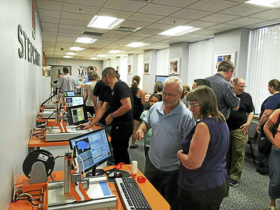 Ben Lambert - The Register CitiznStepcraft, a company that links Torrington and Germany, held an open house and ribbon-cutting Friday. Photo: Journal Register Co.