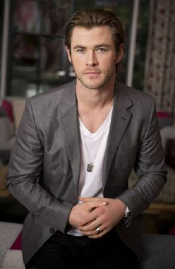 "In this Tuesday, Nov. 5, 2013 photo, Australian actor and star, Chris Hemsworth, of the upcoming film ""Thor: The Dark World,"" poses for a portrait, in New York. Photo: Brian Ach/Invision/AP / Invision"
