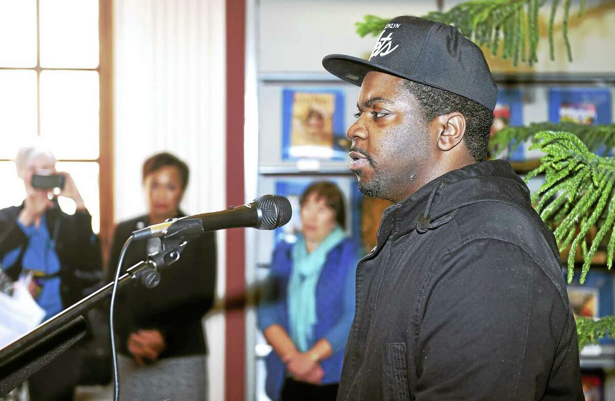 (Arnold Gold-New Haven Register) Keishar Tucker, a survivor of solitary confinement, speaks during a press conference about his experience at the New Haven Free Public Library on 1/30/2017. The library is hosting the display, Inside the Box, will travel to Yale University's Sterling Memorial Library and then to the Lillian Goldman Law Library at the Yale Law School over a three week period and will be accompanied by various programming concerning solitary confinement.