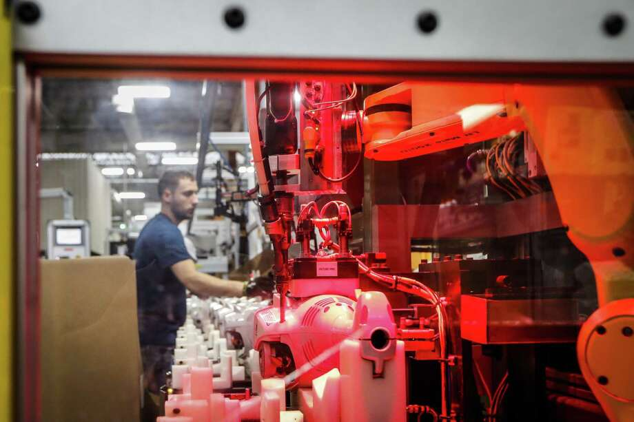 """In this Thursday, May 25, 2017 photo, a collaborative robot uses a power drill to attach parts of a chainsaw body on a assembly line at Stihl Inc. production plant in Virginia Beach, Va. """"The Chinese and Europeans and South Koreans are aggressively embracing robotics,"""" says Howie Choset, a professor of robotics at Carnegie Mellon University in Pittsburgh. """"We definitely are at a point where we have to keep up or get left behind."""" (AP Photo/John Minchillo) Photo: John Minchillo, STF / Associated Press / AP"""