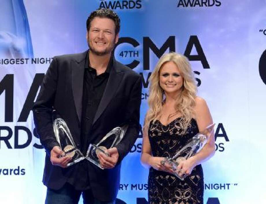 Blake Shelton, left, and Miranda Lambert pose backstage with their awards for male vocalist of the year, album of the year and female vocalist of the year at the 47th annual CMA Awards at Bridgestone Arena on Wednesday, Nov. 6, 2013, in Nashville, Tenn.