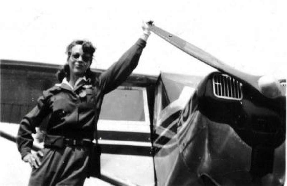 """Dorothy """"Dot"""" Lewis, seen in this undated image next to one of the planes she used to teach male pilots to fly during World War II."""