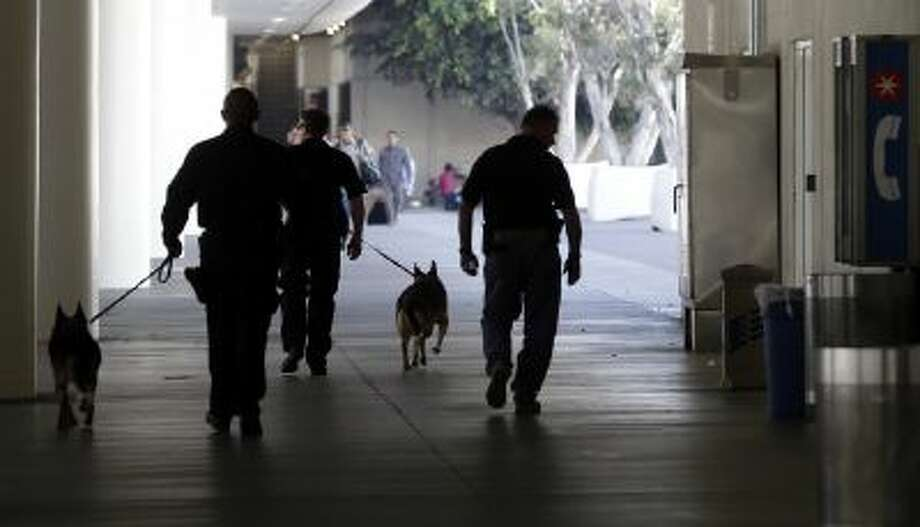 Police check the area around Terminal 1 at Los Angeles International Airport on Friday, Nov. 1, 2013.