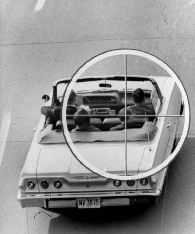 This Nov. 19, 1964 image provided by the Warren Commission shows a reconstruction of the approximate view the assassin of President John Kennedy might have had through the telescopic sight of the rifle fired from the Texas School Book Depository Building on Nov. 22, 1963.