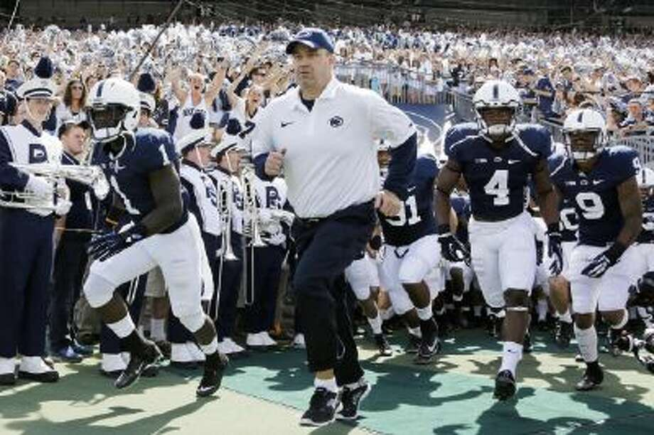 Penn State head coach Bill O' Brien is 15-9 in two seasons under difficult conditions in State College, Pa.