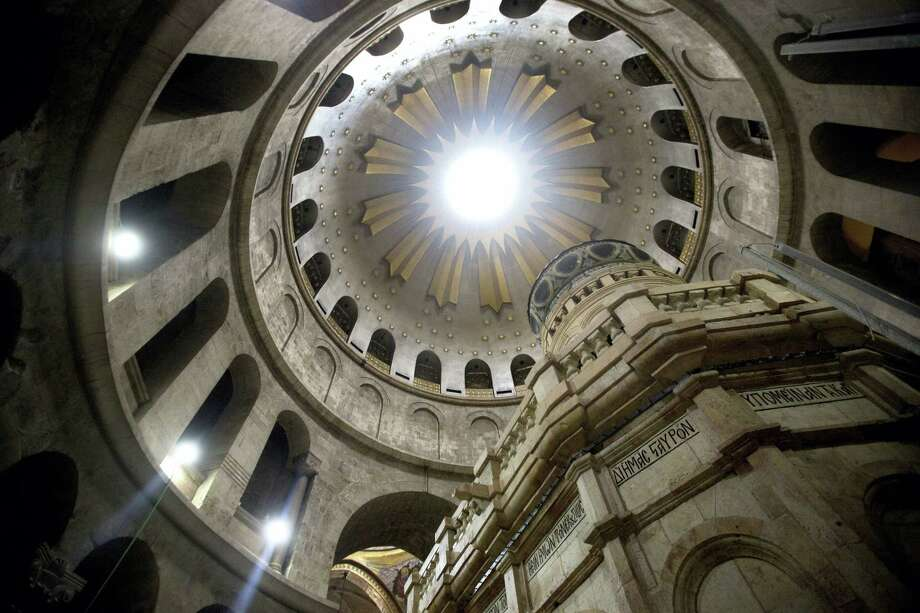 The renovated Edicule is seen in the Church of the Holy Sepulchre, traditionally believed to be the site of the crucifixion of Jesus Christ, in Jerusalem's old city Monday, Mar. 20, 2017. A Greek restoration team has completed a historic renovation of the Edicule, the shrine that tradition says houses the cave where Jesus was buried and rose to heaven. (AP Photo/Sebastian Scheiner) Photo: AP / Copyright 2017 The Associated Press. All rights reserved.