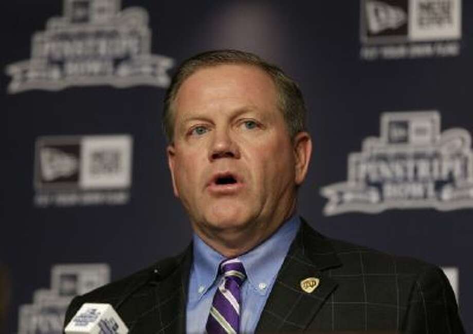 Notre Dame coach Brian Kelly speaks at a press conference for the Pinstripe Bowl, which will be played at Yankee Stadium Dec. 28.
