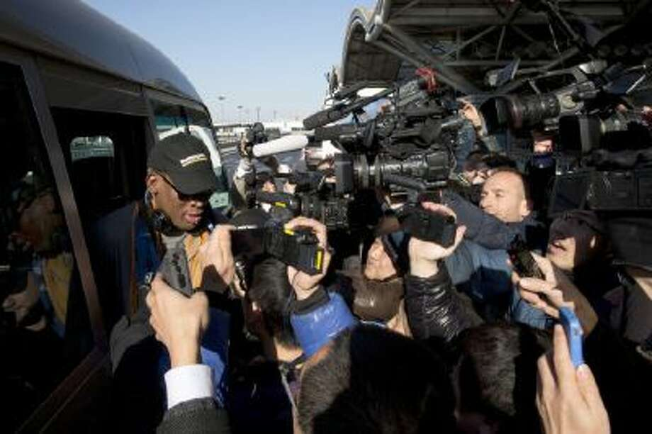 Dennis Rodman arrives at the capital airport for a flight to North Korea in Beijing, China.