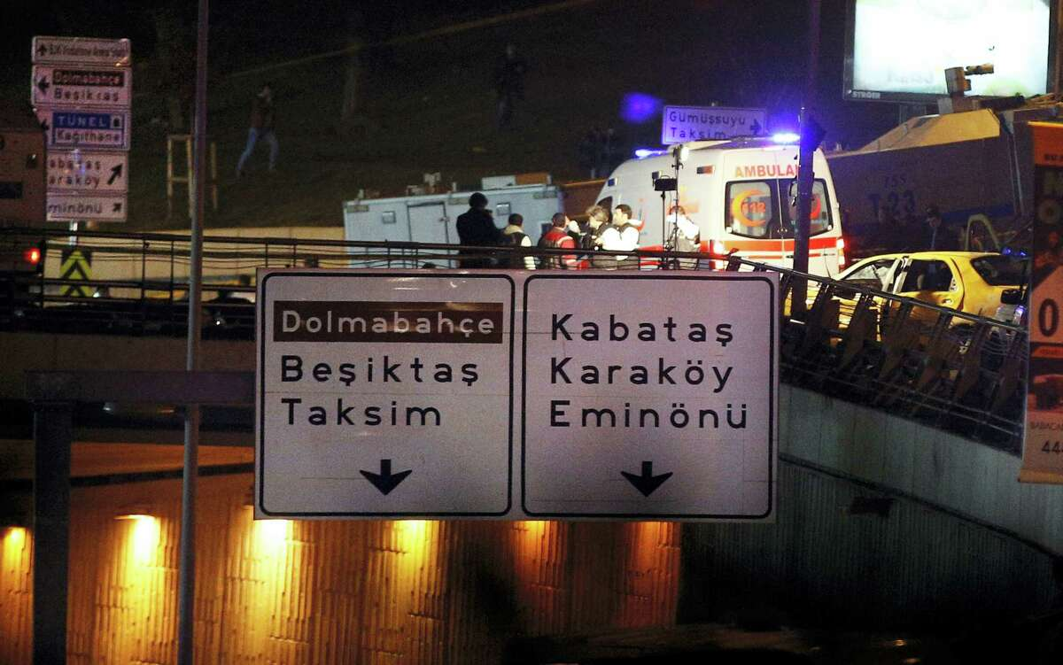 Rescue services work at the scene of explosions near the Besiktas football club stadium, in Istanbul, late Saturday, Dec. 10, 2016. Two loud explosions have been heard near the newly built soccer stadium and witnesses at the scene said gunfire could be heard in what appeared to have been an armed attack on police. Turkish authorities have banned distribution of images relating to the Istanbul explosions within Turkey. (AP Photo/Emrah Gurel) TURKEY OUT