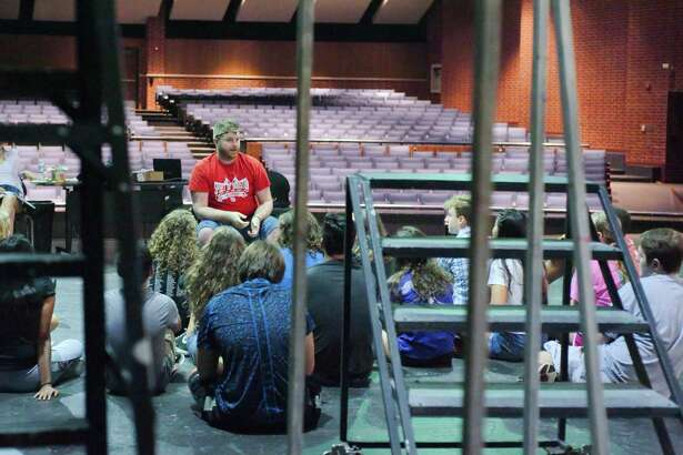 Dawson High School Theater Director John Grimmett discusses a scene in Godspell with his students Friday, Aug 4.