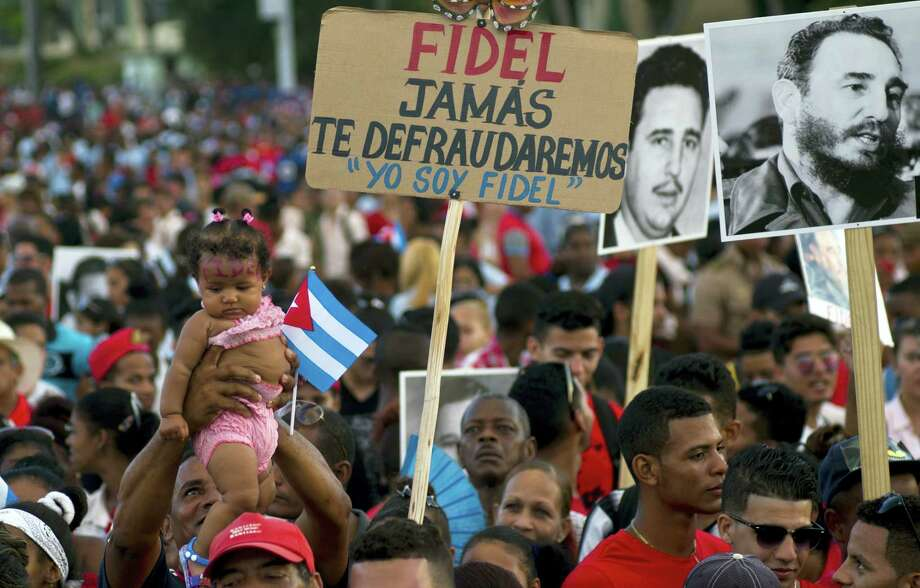 People waits for the beginning of a rally honoring Cuba's leader Fidel Castro before his burial Sunday at the Plaza Antonio Maceo in Santiago, Cuba, Saturday, Dec. 3, 2016. The sign reads in Spanish 'Fidel we will never let you down. I am Fidel.'(AP Photo/Ramon Espinosa) Photo: AP / Copyright 2016 The Associated Press. All rights reserved.