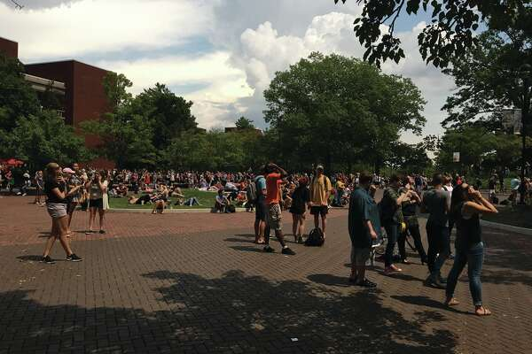 Taking a break from the first day of classes, hundreds of students at SIUE gather on the campus quad to take in Monday's eclipse. They erupted in a cheer when totality was achieved.
