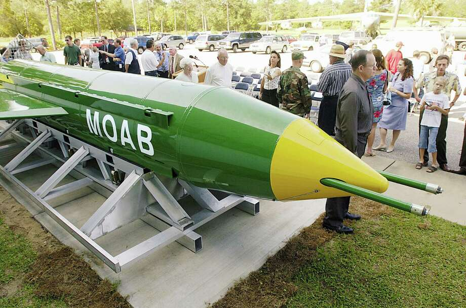 In this May 2004 photo, a group gathers around a GBU-43B, or massive ordnance air blast (MOAB) weapon, on display at the Air Force Armament Museum on Eglin Air Force Base near Valparaiso, Fla. U.S. forces in Afghanistan struck an Islamic State tunnel complex in eastern Afghanistan on Thursday, April 13, 2017, with a GBU-43B, the largest non-nuclear weapon ever used in combat by the U.S. military, Pentagon officials said. (Mark Kulaw/Northwest Florida Daily News via AP) Photo: AP / Northwest Florida Daily News