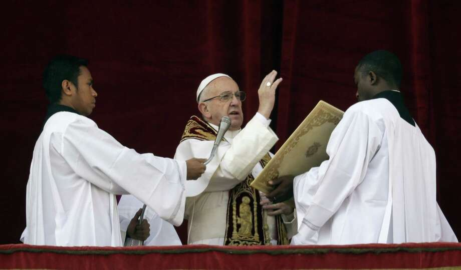 Pope Francis delivers the Urbi et Orbi (Latin for ' to the city and to the world' ) Christmas' day blessing from the main balcony of St. Peter's Basilica at the Vatican, Sunday, Dec. 25, 2016. (AP Photo/Alessandra Tarantino) Photo: AP / Copyright 2016 The Associated Press. All rights reserved.