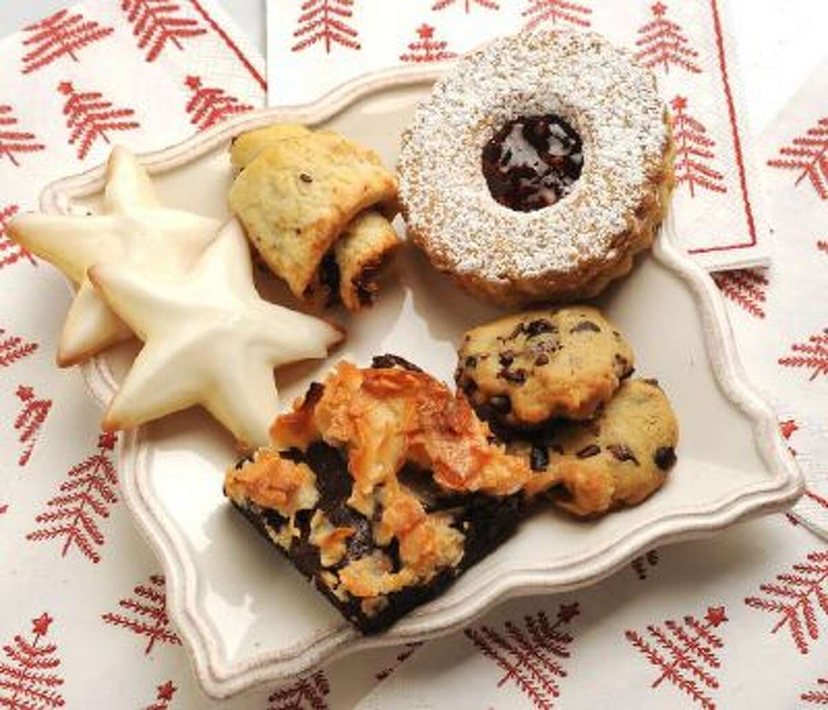 Clockwise from top right, Raspberry Linzer Cookie, Nibby Cookies, Lacy Coconut Brownie, Sugar Cookie Stars and Hamentaschen with Cocoa Nibs and Currants, photographed in Walnut Creek, Calif., on Tuesday, Dec. 2, 2013.