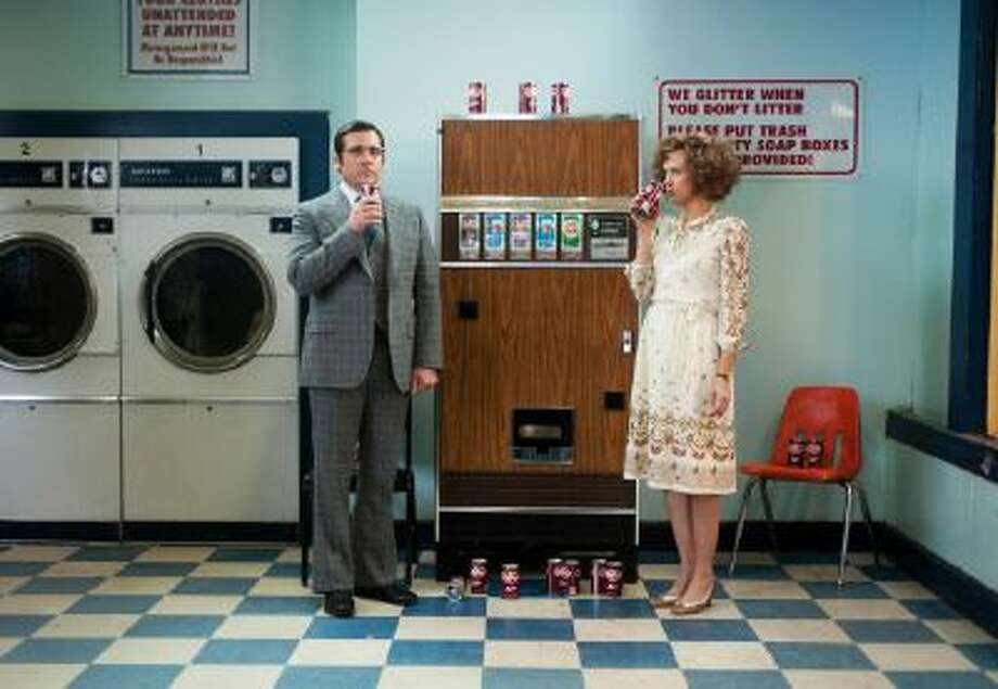 "This photo provided by Paramount Pictures shows Steve Carell, left, as Brick Tamland and Kristen Wiig as Chani Lastnamé, in a scene from the film, ""Anchorman 2: The Legend Continues."" Paramount Pictures releases the film in the U.S. on Dec. 18, 2013."