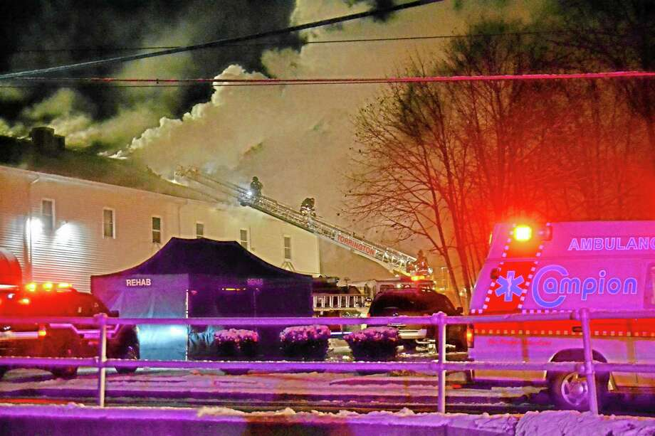 Tom Cleary Register Citizen Firefighters battled a 3-alarm blaze at Carl's True Value on North Elm Street in Torrington early Wednesday morning, Dec. 11, 2013. Photo: Journal Register Co.