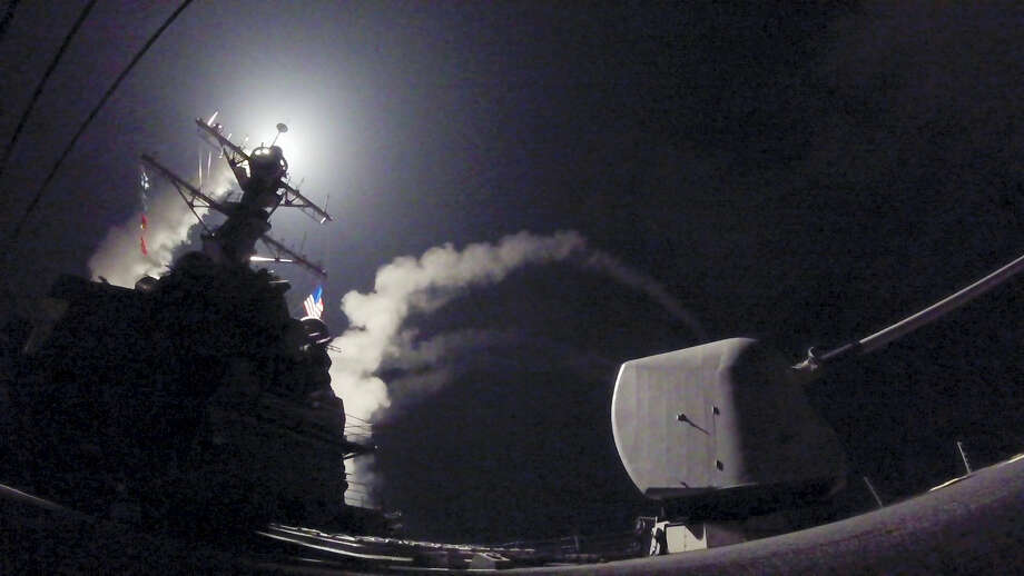 In this image provided by the U.S. Navy, the guided-missile destroyer USS Porter (DDG 78) launches a tomahawk land attack missile in the Mediterranean Sea, Friday, April 7, 2017. The United States blasted a Syrian air base with a barrage of cruise missiles in fiery retaliation for this week's gruesome chemical weapons attack against civilians.  (Mass Communication Specialist 3rd Class Ford Williams/U.S. Navy via AP) Photo: AP / Public Domain