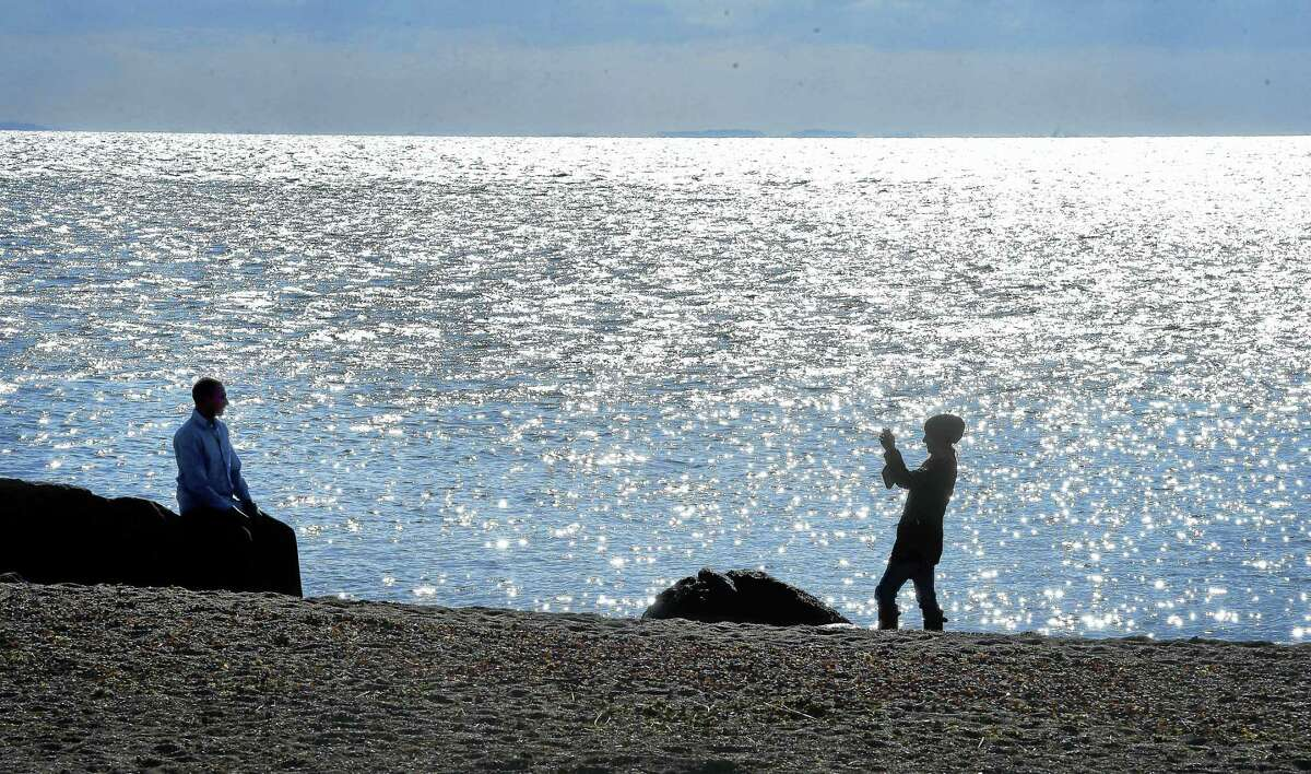 (Arnold Gold-New Haven Register) Aaron Saramak (left) of Burlington, Connecticut, has his photograph taken by his life partner, Sandy Bonola, at Meigs Point at Hammonasset Beach State Park in Madison on 1/8/2015.
